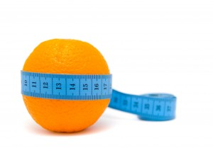 Fruit with measuring tape. isolated on white